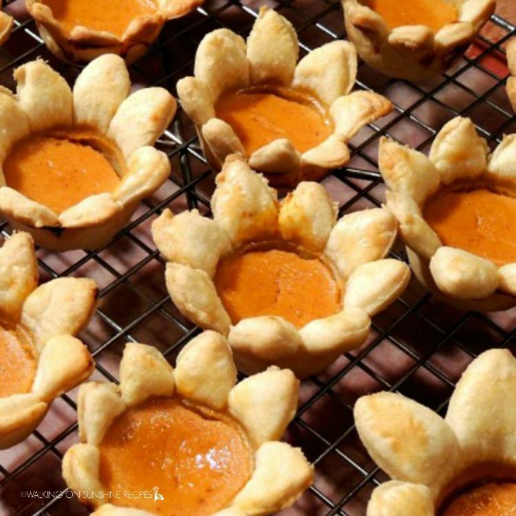 Flower Shaped Mini Pumpkin Pies on cooling rack.