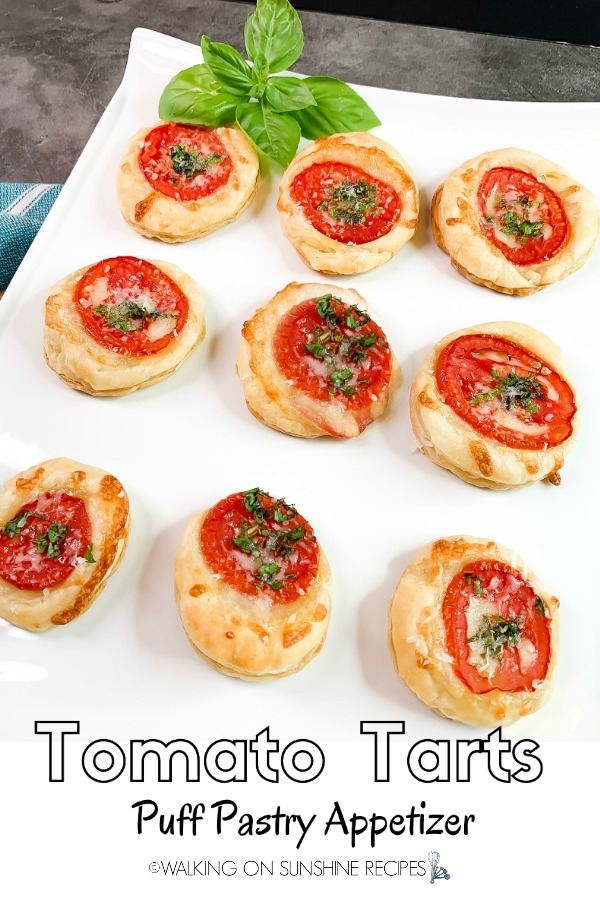 Tomato Tarts Puff Pastry Appetizer on White Tray with Basil Leaves