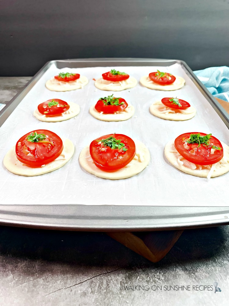 Tomato Tarts with chopped herbs before baking
