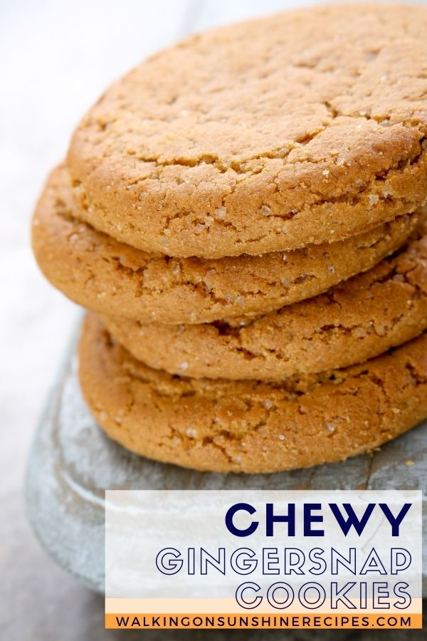 Chewy Gingersnap cookies stacked on marble stone.
