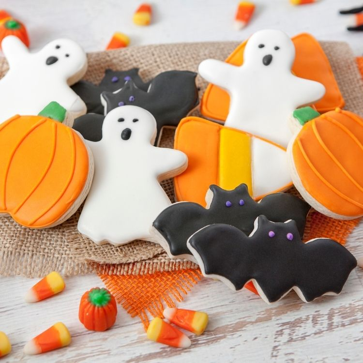 sugar cookies in shapes of bats, ghosts and pumpkins.