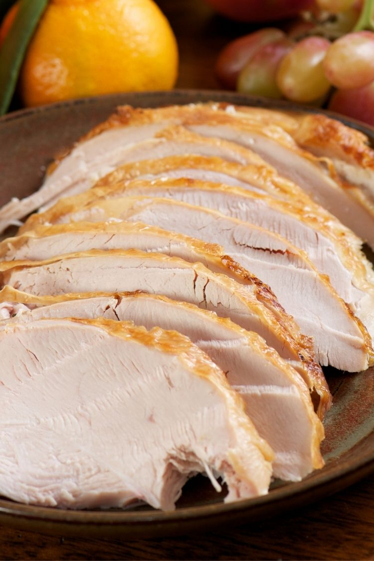 Sliced turkey on platter.