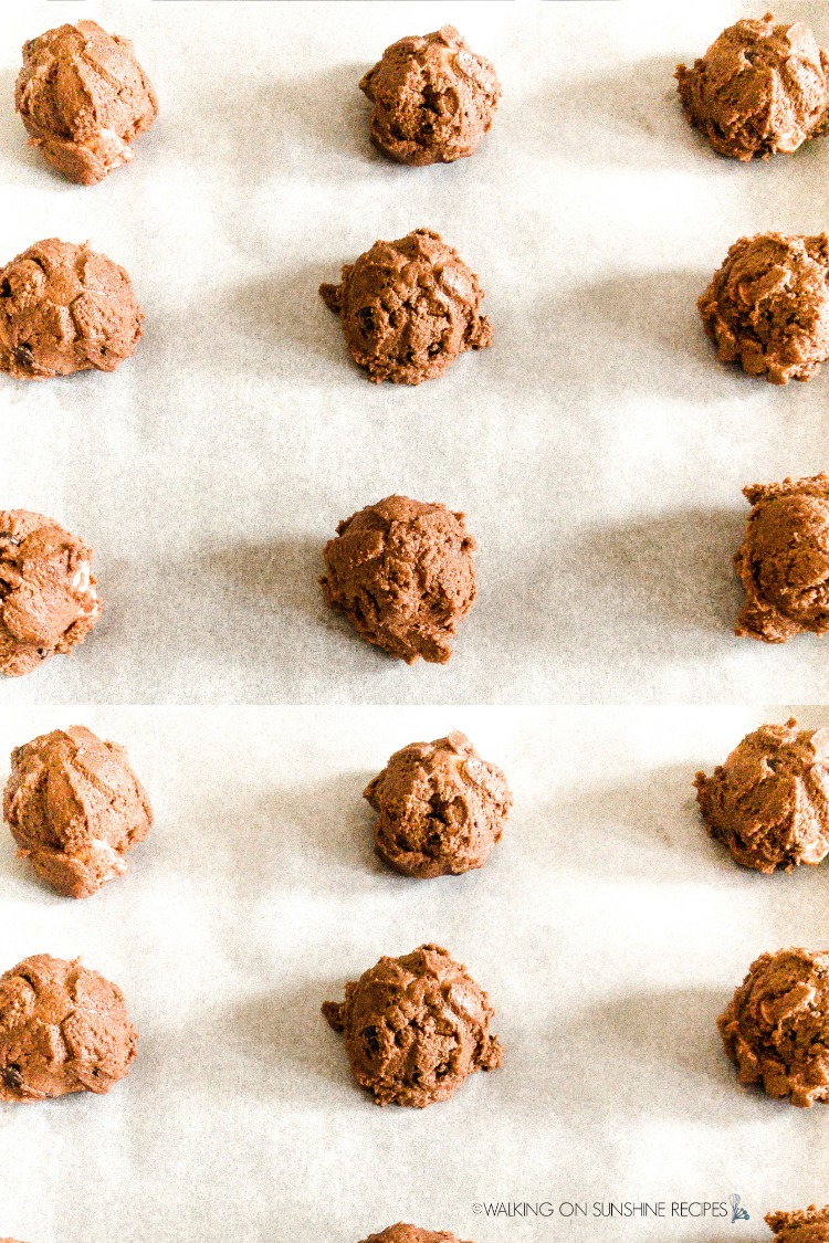 Mounds of Chocolate Marshmallow Cookies on baking tray before placing in oven.