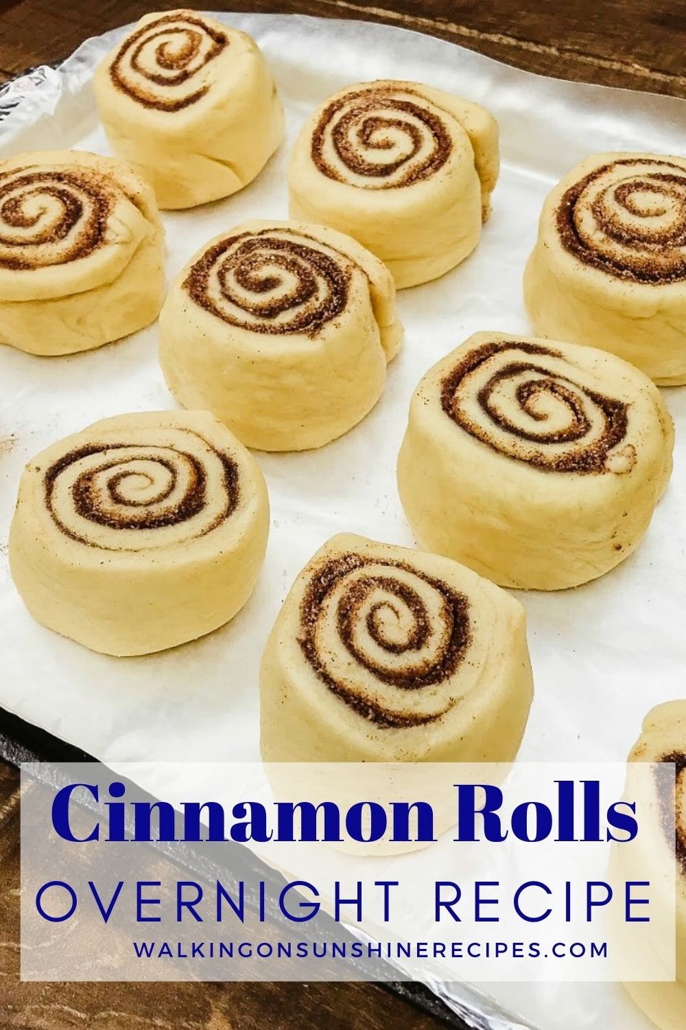 cinnamon rolls on baking tray ready for oven.