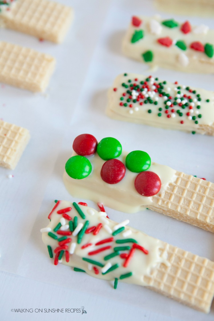 wafer sugar cookies with melted chocolate and sprinkles
