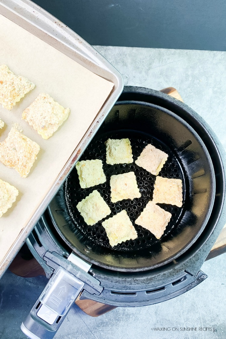 Add breaded mini ravioli to air fryer basket