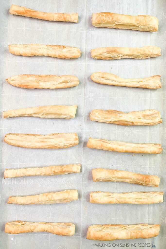 Baked Puff Pastry sticks on baking sheet