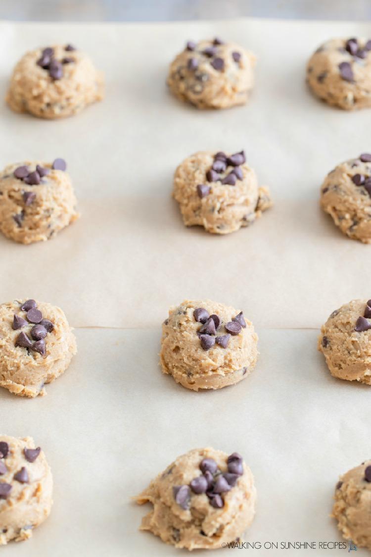 baking frozen cookie dough balls on baking tray.