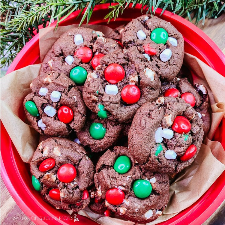 Marshmallow Christmas Cookies in red bowl with parchment paper.