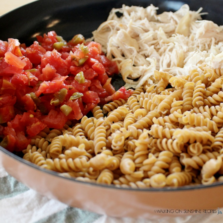 Pasta, Tomatoes and chicken in skillet.