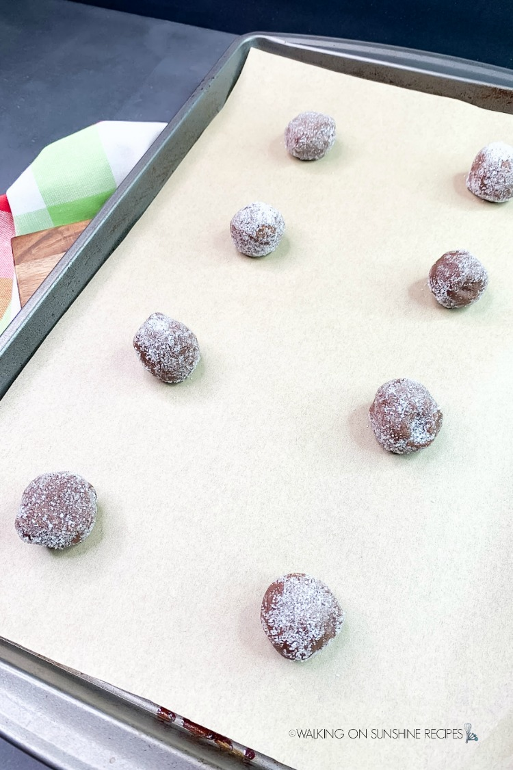 Place cookie balls rolled in sugar on baking tray