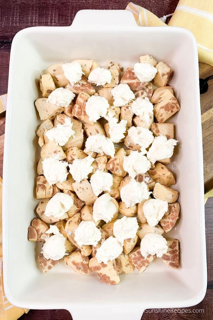 Add cream cheese filling to Pillsbury Cinnamon Rolls Casserole.