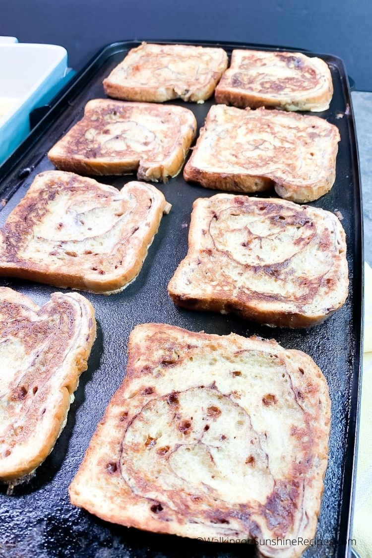 Perfectly baked Cinnamon Roll French Toast on electric skillet