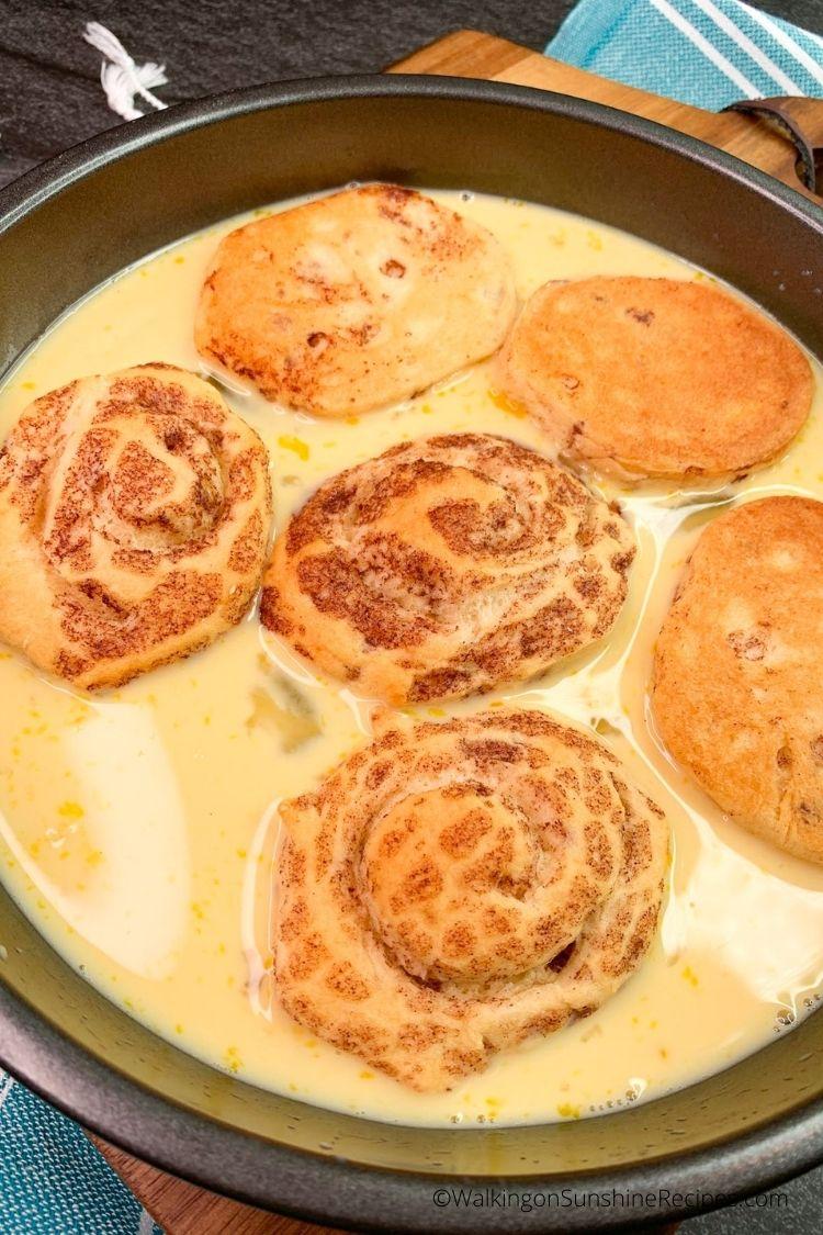 Dip cinnamon rolls in egg custard for French toast.