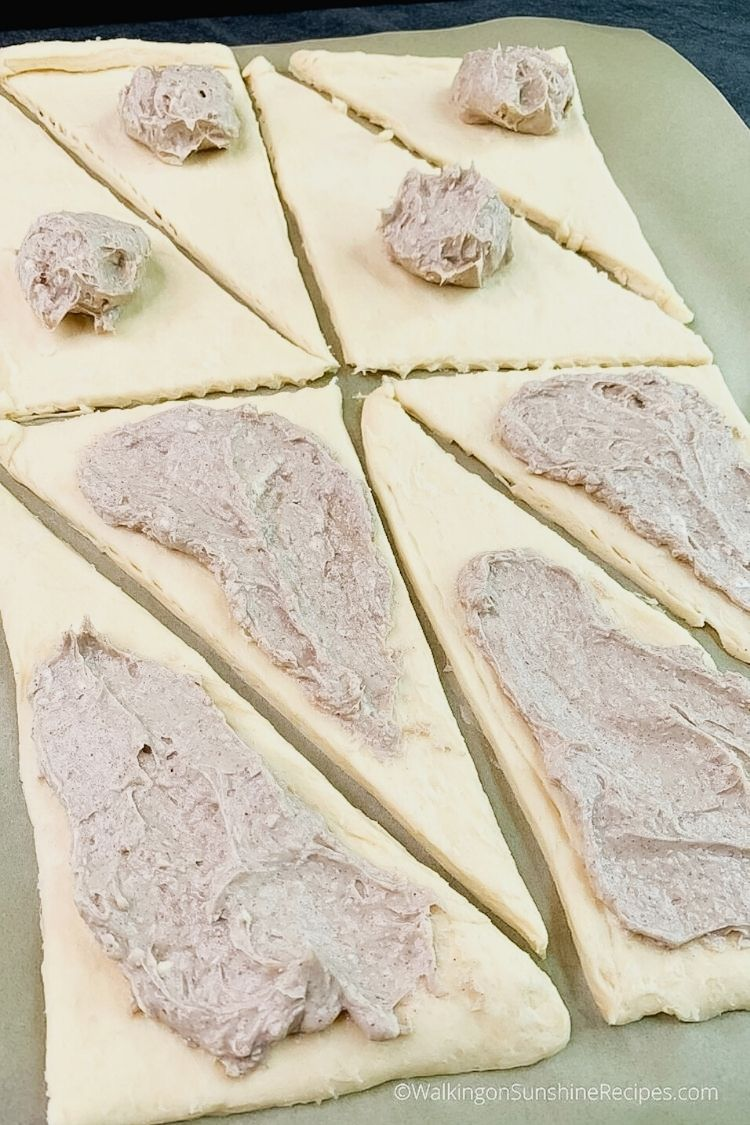Spread cream cheese mixture on top of crescent rolls.