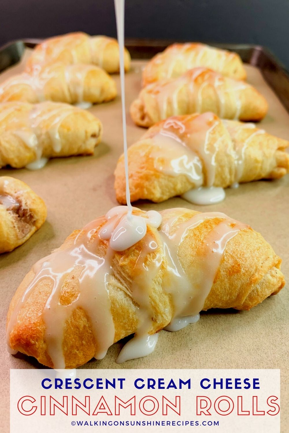 Cinnamon Roll Cream Cheese Crescents with glaze drizzled on top.