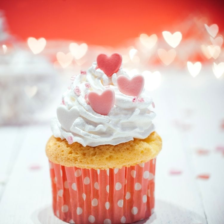 vanilla cupcake with pink hearts