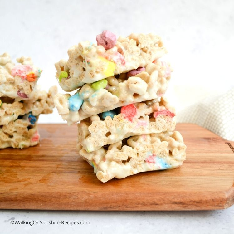 Lucky Charms Cereal Bar Treats on wooden board.