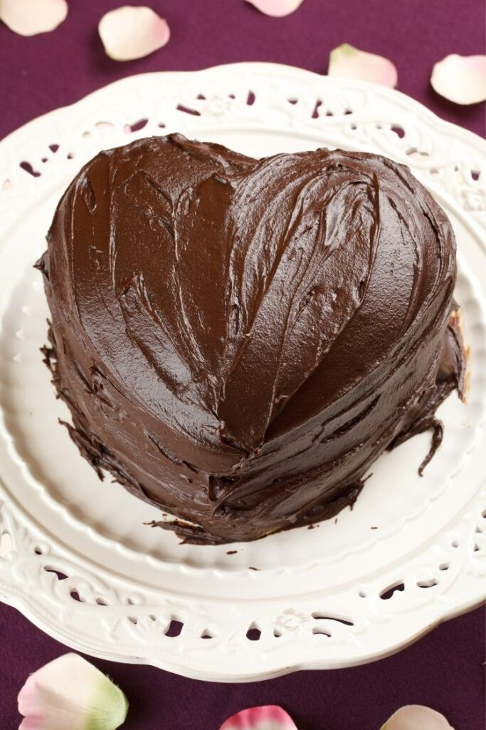 heart cake shape with chocolate frosting.