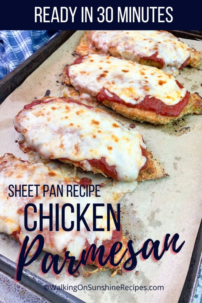 Baked chicken cutlet Parmesan on sheet pan.