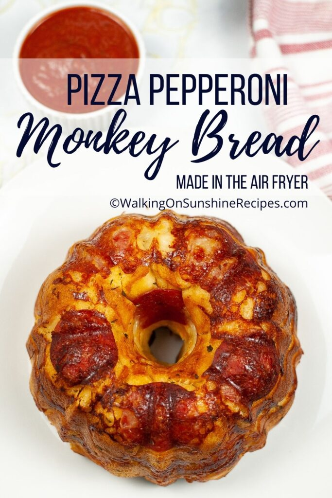 Pizza monkey bread filled with cheese and pepperoni baked in a bundt pan in the air fryer.