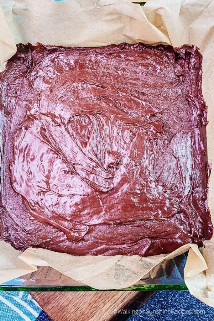 chocolate fudge in parchment lined baking dish.