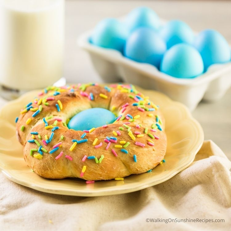 Easter bread ring with blue egg and sprinkles.