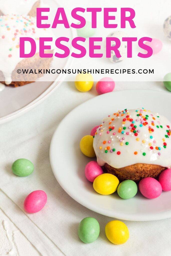mini cakes with icing, sprinkles and candy eggs.