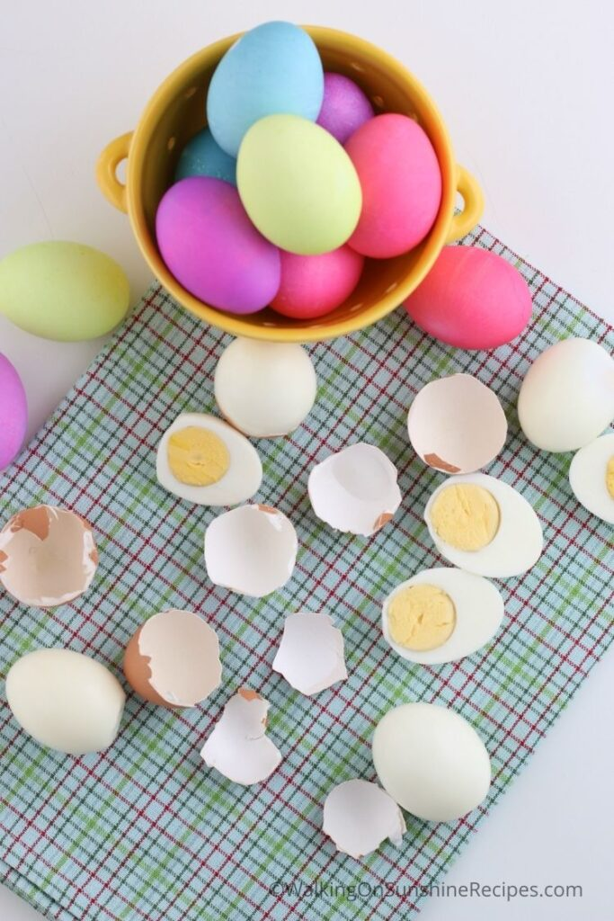 colored Easter eggs and cracked peeled eggs.