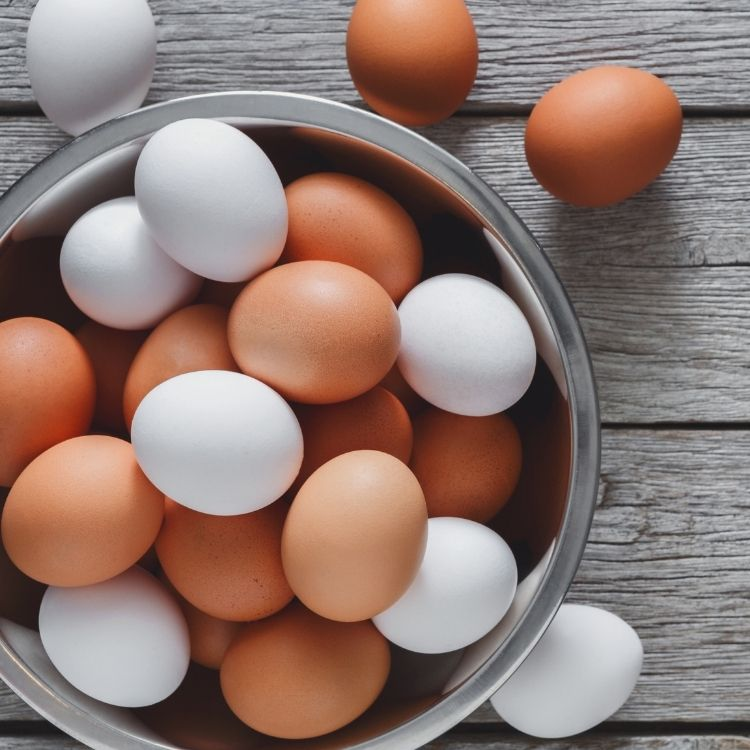 bowl of white and brown eggs.