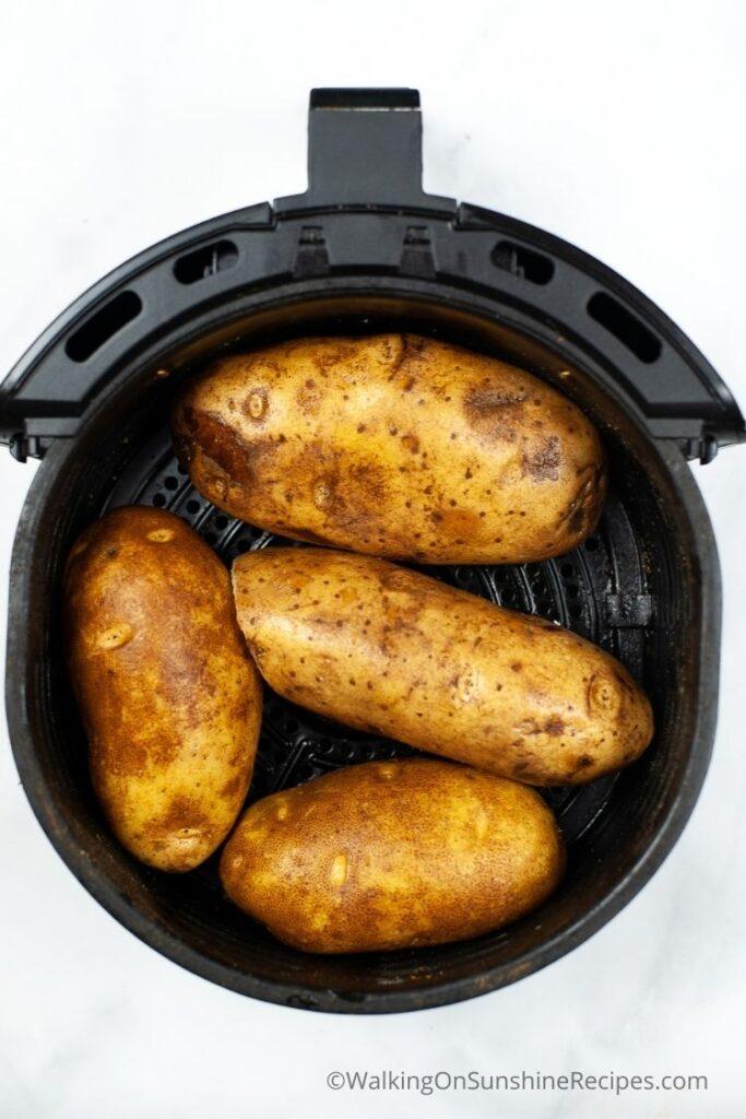 cooking russet potatoes in an air fryer.