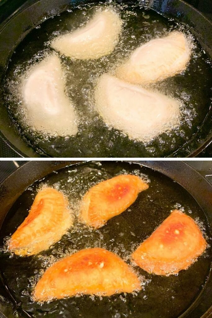 Frying hand pies in cast iron skillet with oil.
