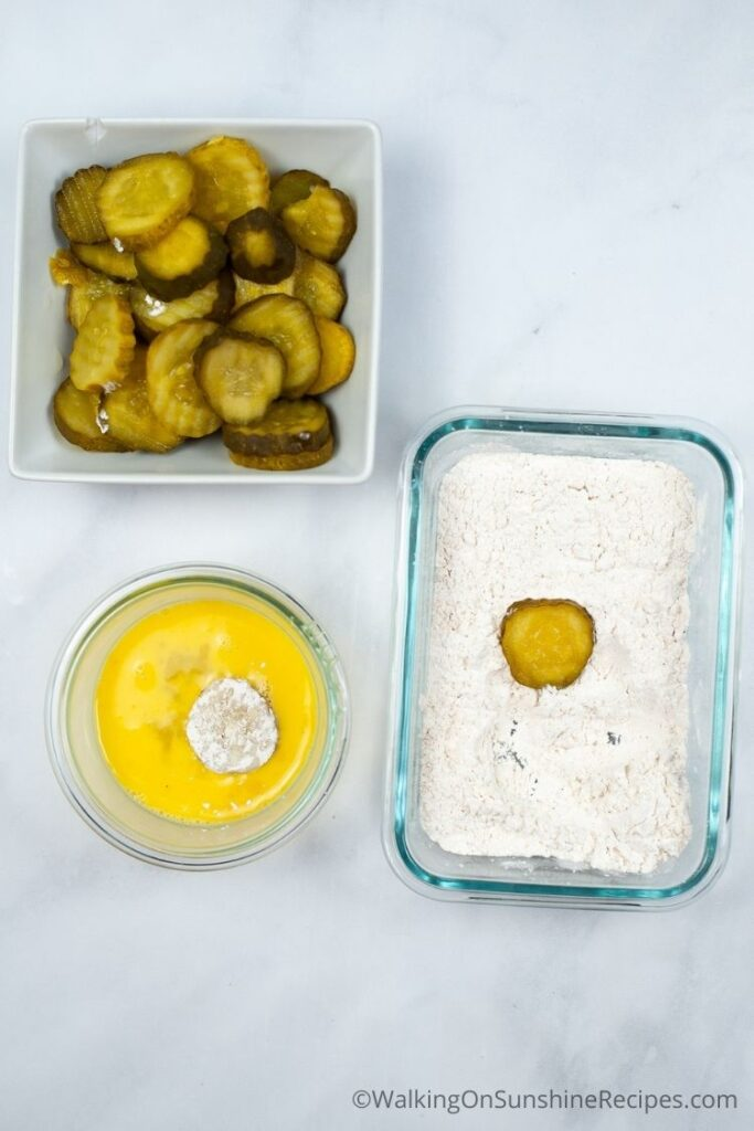 Dip pickles in egg and flour.