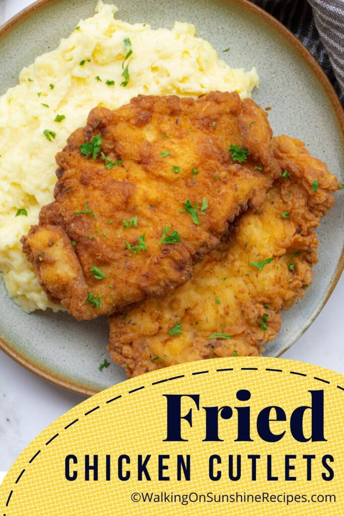 Crispy fried chicken cutlets with mashed potatoes.