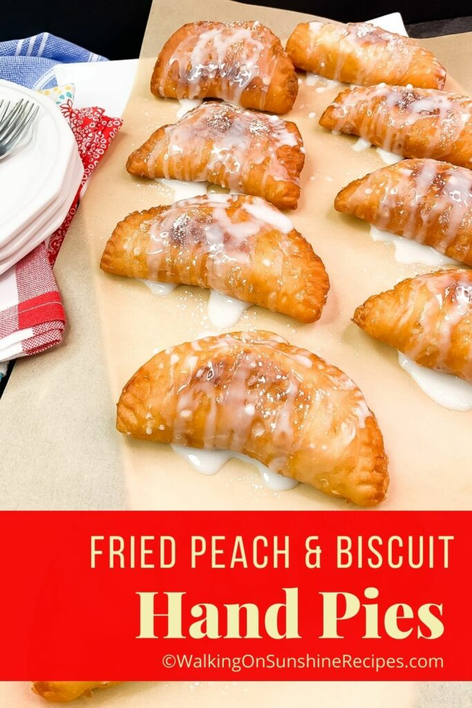 fried hand pies on parchment paper with glaze.