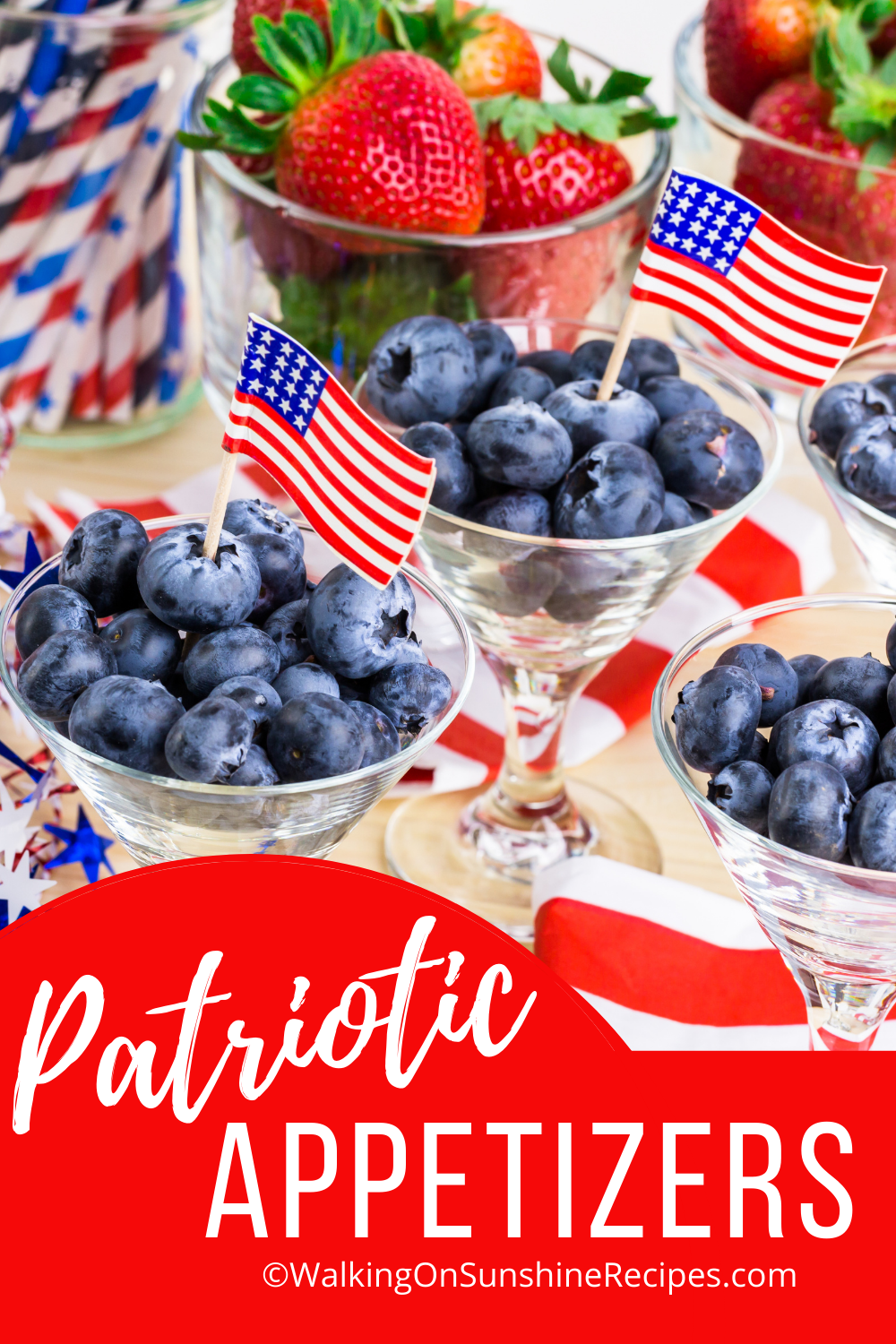 blueberries in cups with mini American flags.
