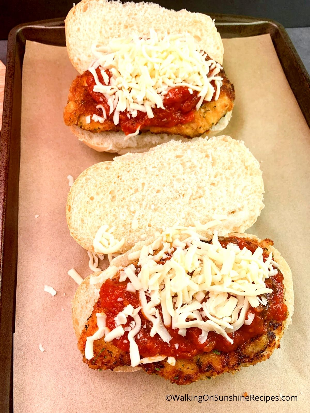 Cheese and Marinara Sauce on top of chicken cutlets.