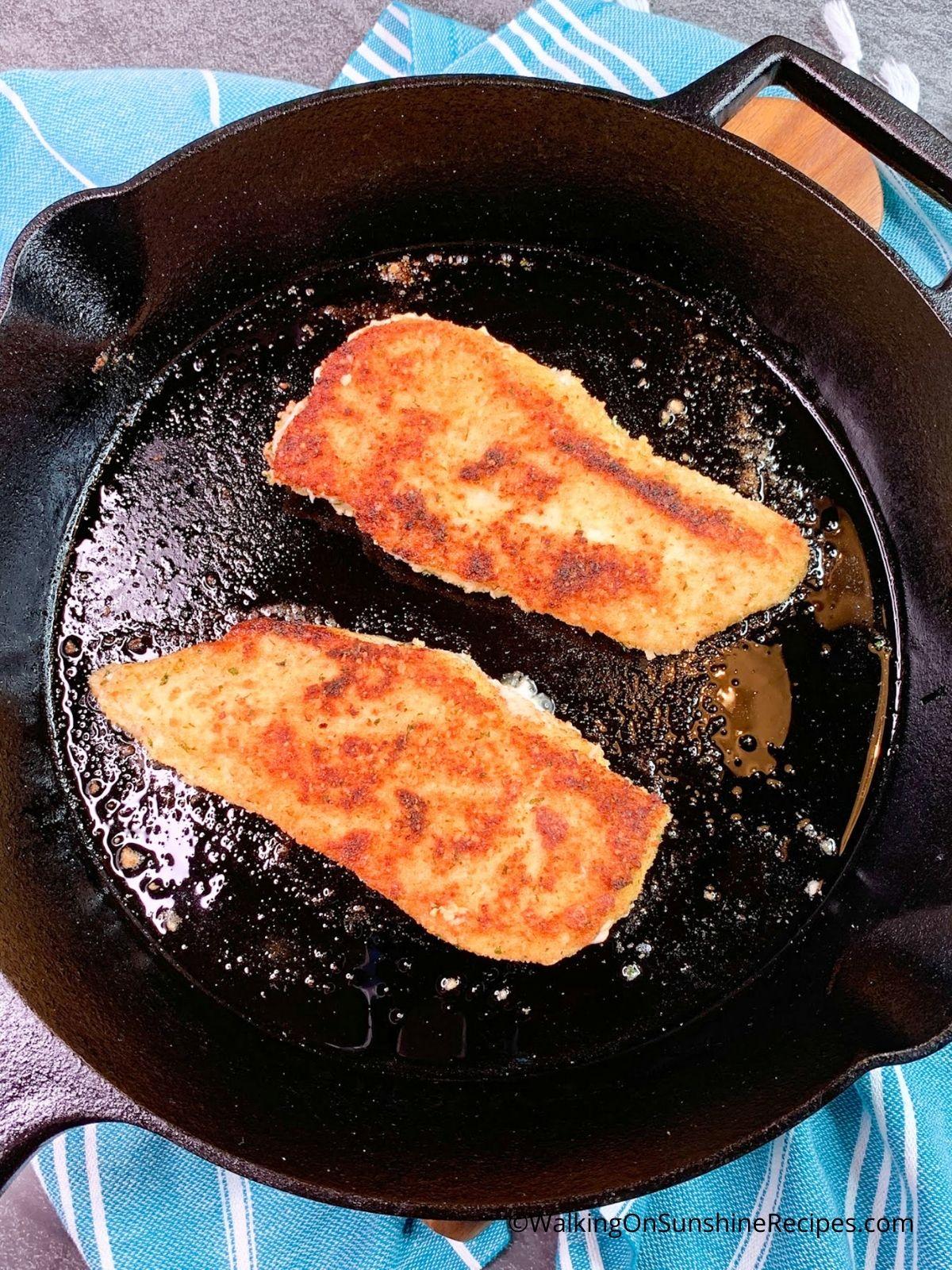 Chicken in cast iron  skillet.