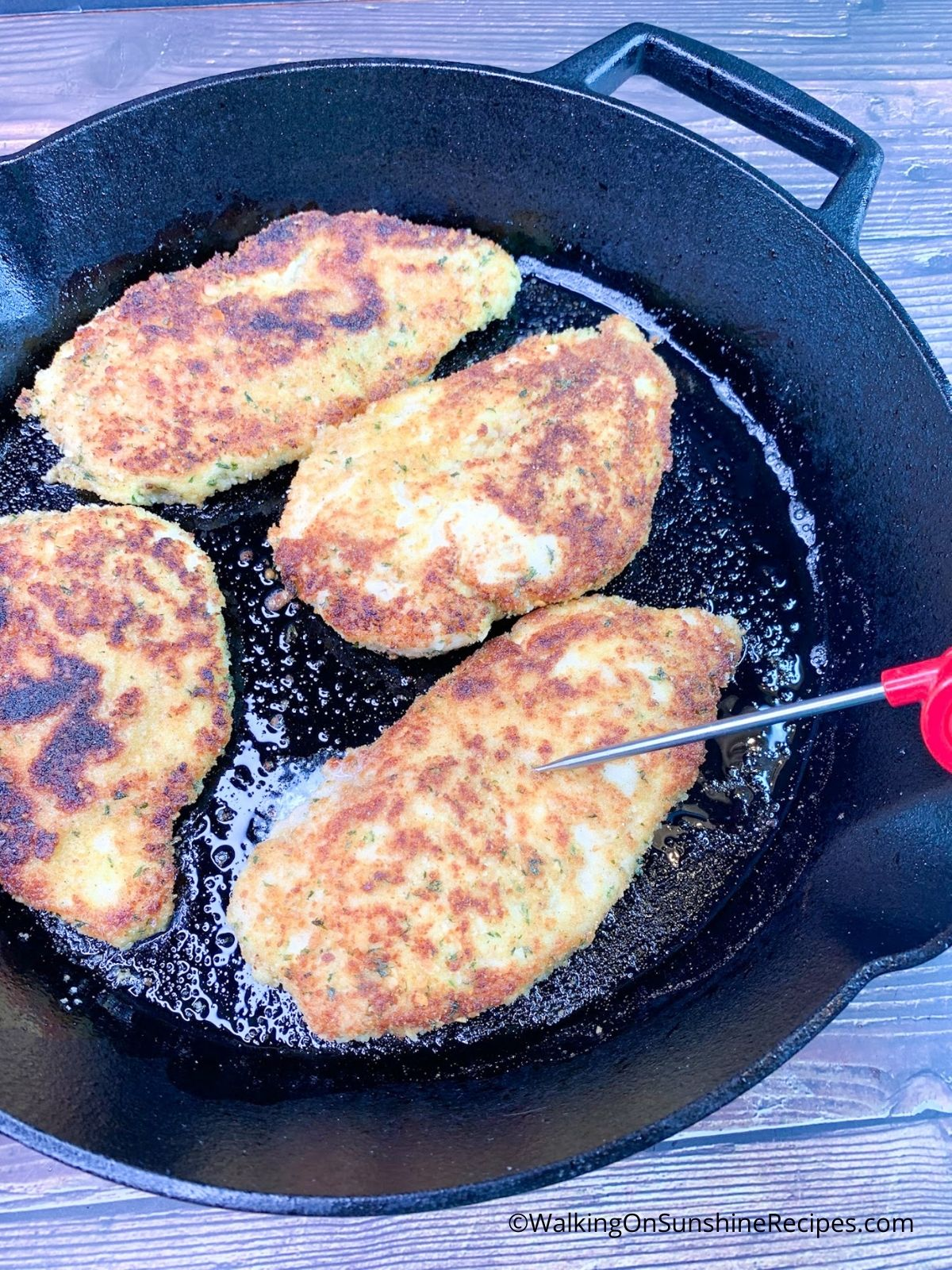 Cooked Perdue chicken cutlets in cast iron skillet.