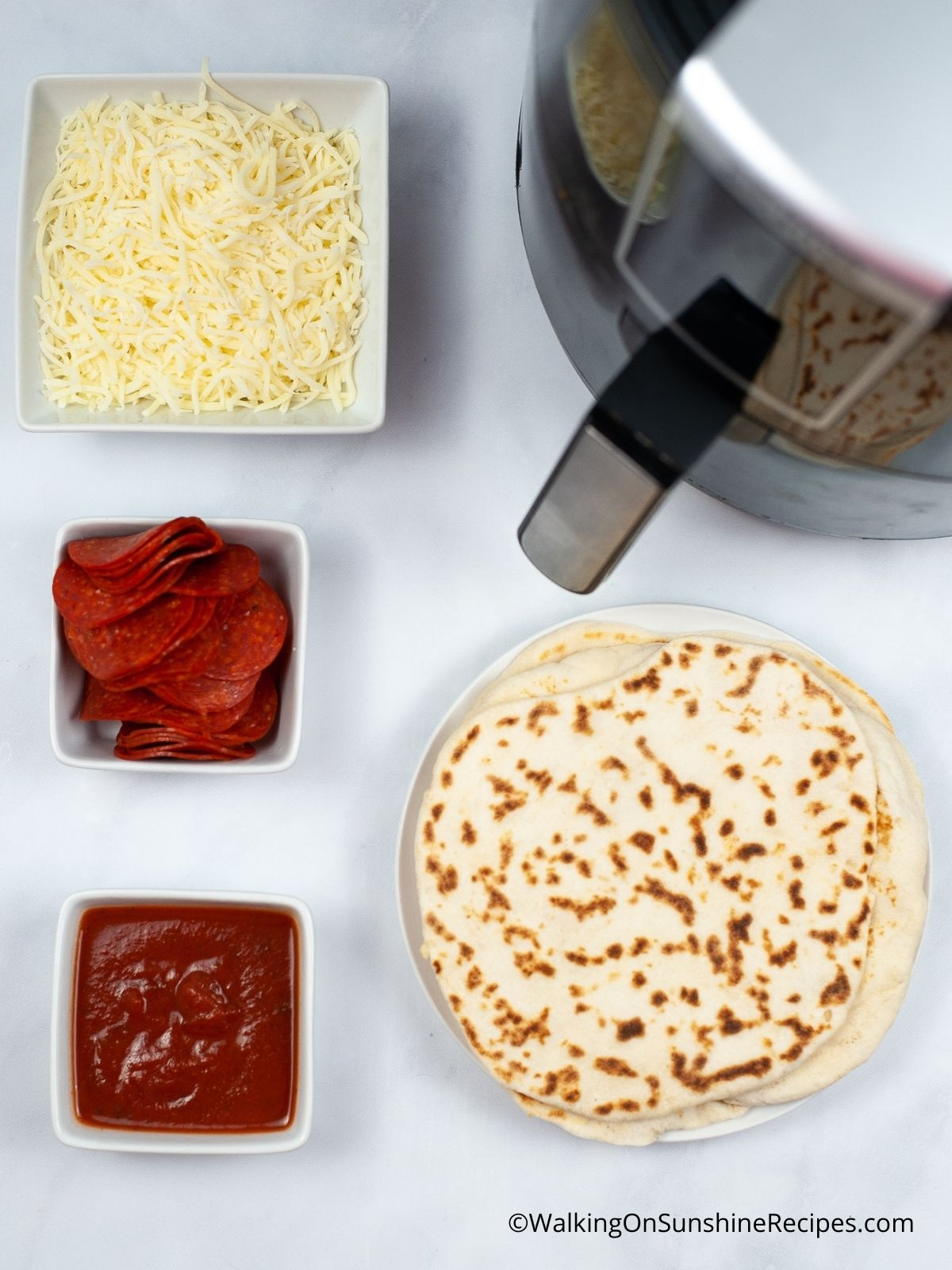 Ingredients for Pre-made crust air fryer pizza.