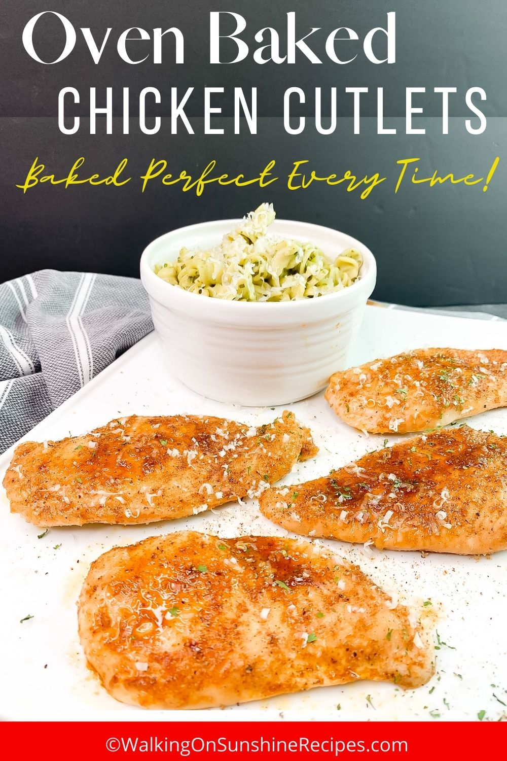 chicken cutlets on white baking dish with bowl of pasta.