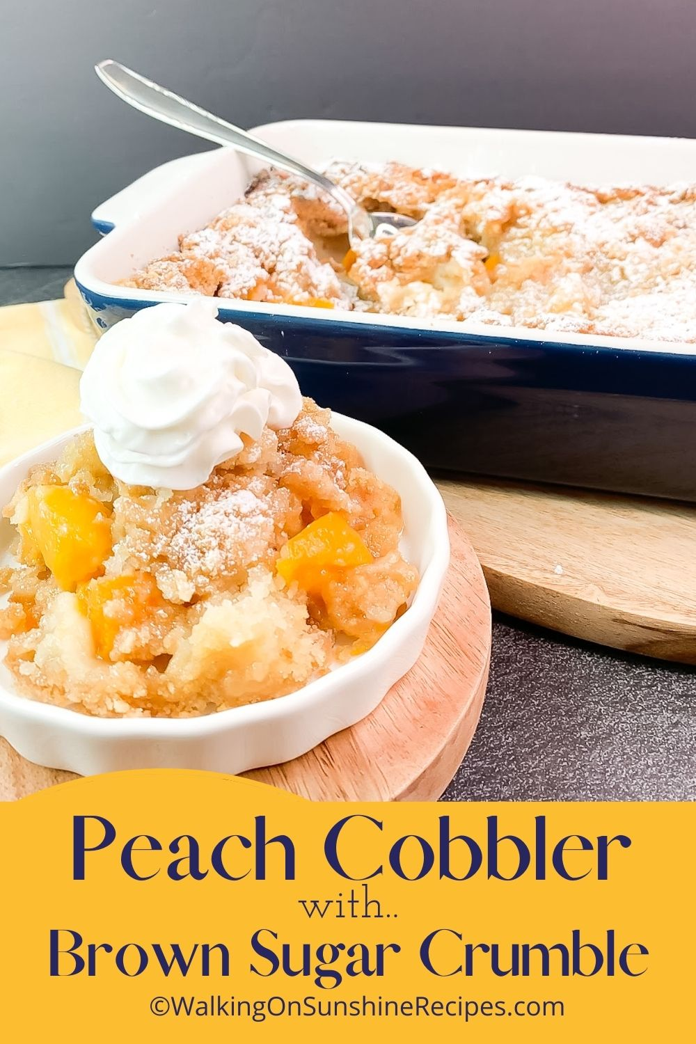 Peach cobbler in small bowl with whipped cream on top.