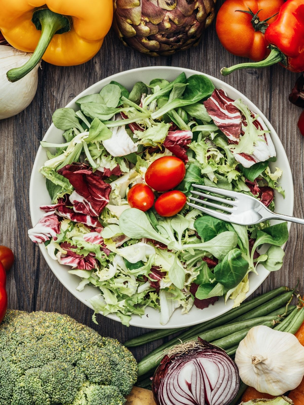 green lettuce salad with grape tomatoes.
