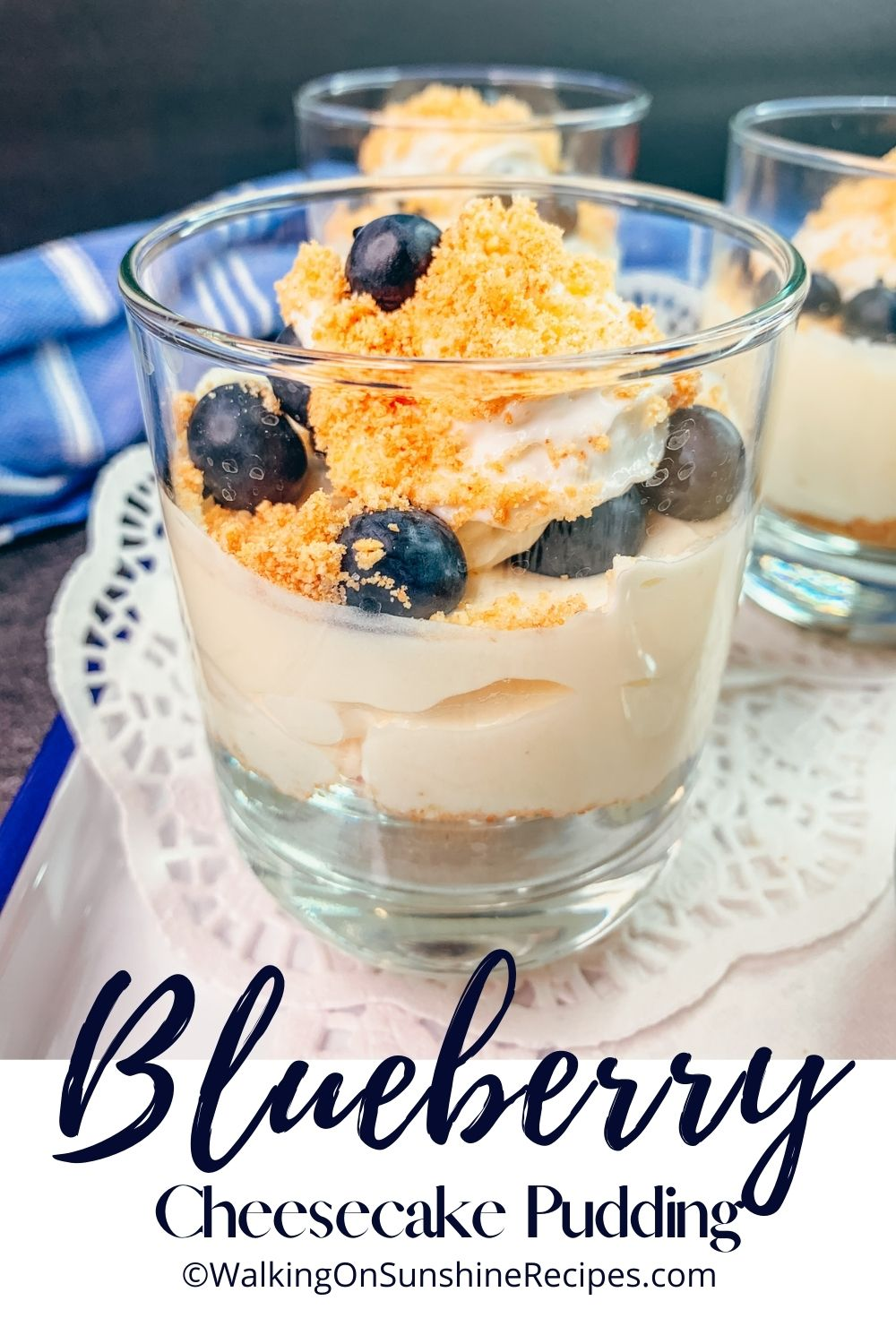 cheesecake pudding in cup with blueberries on top.