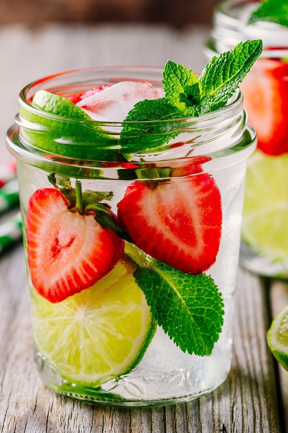 Infused water with strawberries and lime slices.