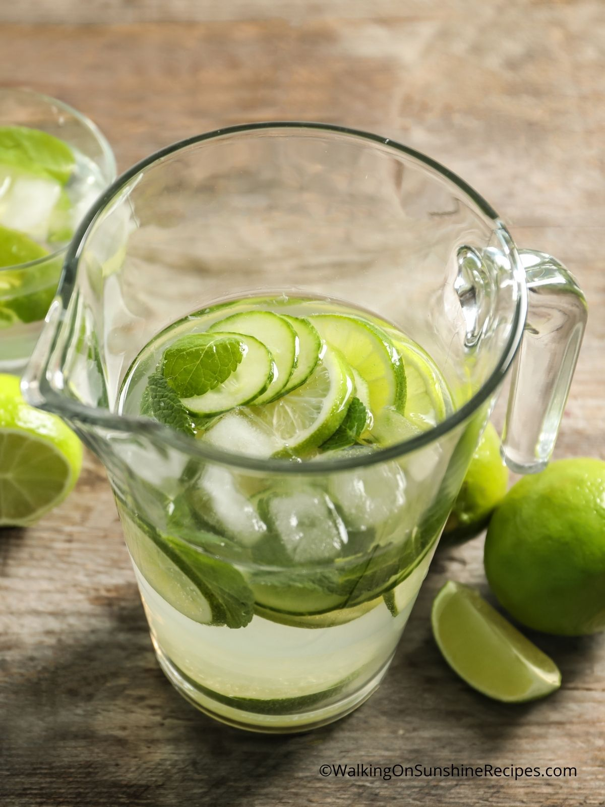 pitcher with water and fresh lime slices.