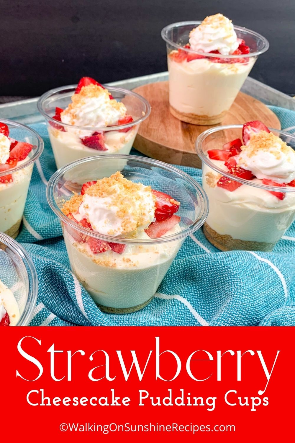 Small cups filled with pudding and fresh strawberries.