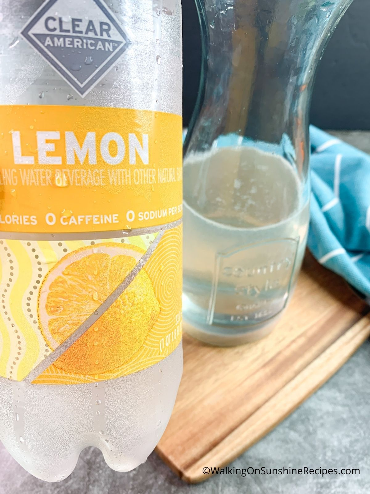 Add Lemon Sparkling Water to pitcher.