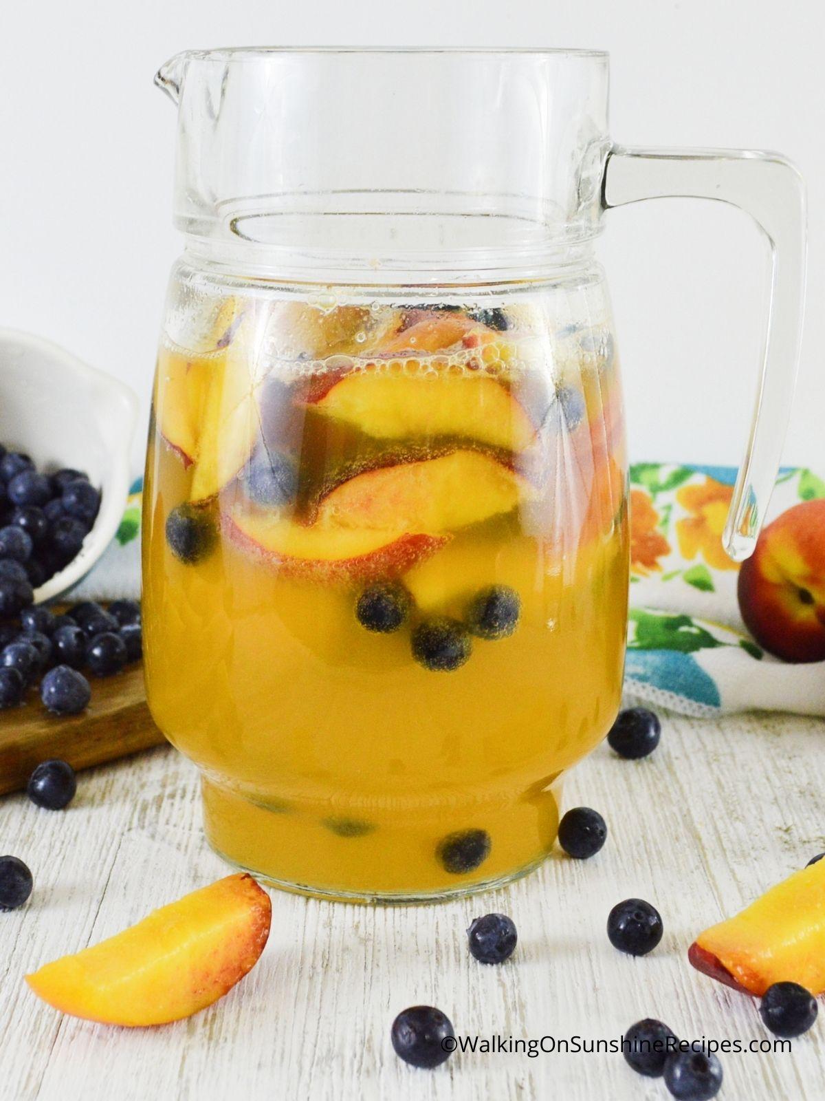 Non-Alcoholic Sparkling Peach Sangria in pitcher.