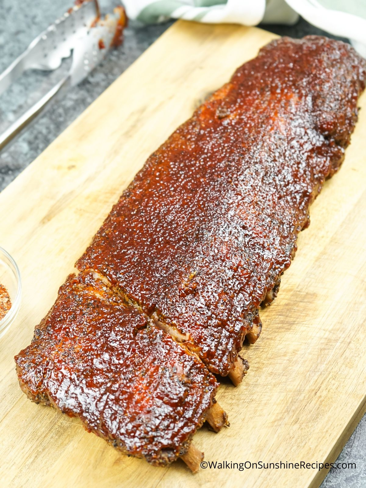Oven baked ribs on cutting board